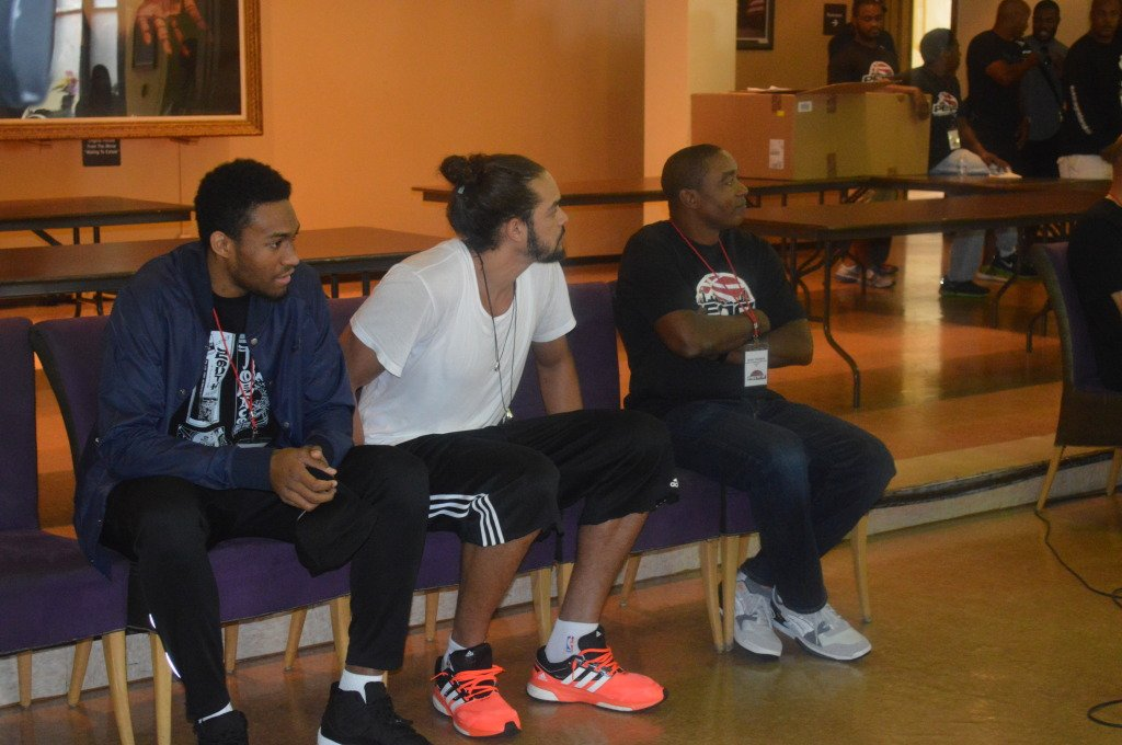 (From left) Jabari Parker, Joakim Noah, and Isiah Thomas speak to PEACE Tournament participants.