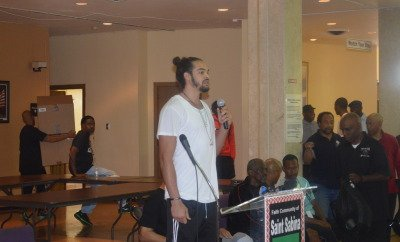 Joakim Noah speaks to the PEACE Tournament participants.