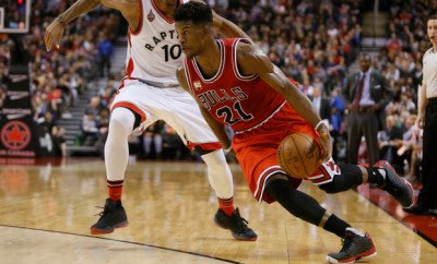 Jan 3, 2016; Toronto, Ontario, CAN; Chicago Bulls guard Jimmy Butler (21) dribbles around Toronto Raptors guard DeMar DeRozan (10) at the Air Canada Centre. Chicago defeated Toronto 115-113. Mandatory Credit: John E. Sokolowski-USA TODAY Sports