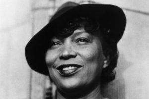 "Corbis Images #IH023962 MAY ONLY BE USED IN CONNECTION WITH ""American Masters: Zora Neale Hurston"". All other uses are prohibited. ca. 1950s, Florida, USA [?] --- Zora Neale Hurston (1903-1960) studied anthropology under scholar Franz Boas. She wrote several novels, drawing heavily on her knowledge of human development and the African American experience in America. She is best known for --- Image by © CORBIS"